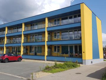 Gevelrenovatie en plaatsen liften 18 appartementen Schelle (Schelle) - voorgevel na