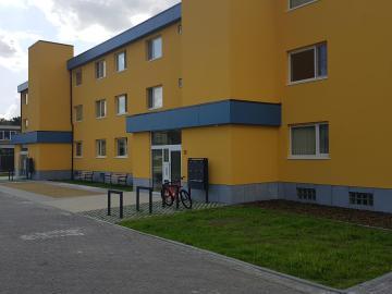 Gevelrenovatie en plaatsen liften 18 appartementen Schelle - Achtergevel na